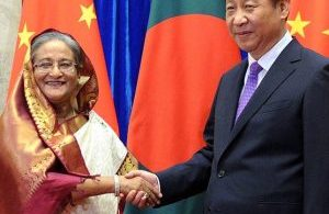 Bangladesh's Prime Minister Sheikh Hasina, left, shakes hands with Chinese President Xi Jinping at the Great Hall of the People in Beijing on Tuesday, June 10, 2014. (AP Photo/Wang Zhao, Pool)