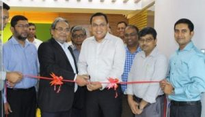 Photo: Managing Director M.A. Jabbar and Deputy Managing Director M.A. Quader cutting ribbon to open the new office in Dhaka