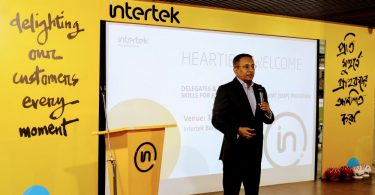 sandeep-das-country-managing-director-of-intertek-bangladesh-addressing-all-participants-and-delegates-in-the-event