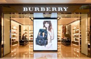 HONG KONG - JANUARY 26, 2016: entryway of Burberry store at Elements Shopping Mall. Burberry Group plc is a British luxury fashion house, distributing outerwear, fashion accessories, fragrances, sunglasses, and cosmetics.